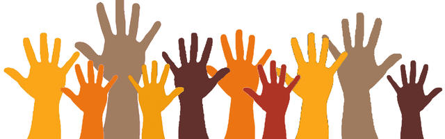 People volunteering by raising their hands