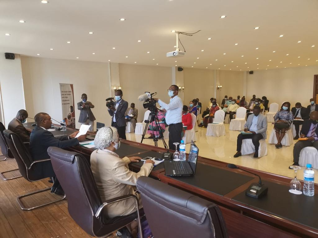 Journalists film as the Minister of Agriculture opens the SARE workshop in Gabon for rabies elimination planning with GARC and FAO